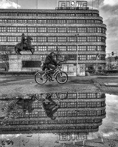 A horesman a biker and a puddle
