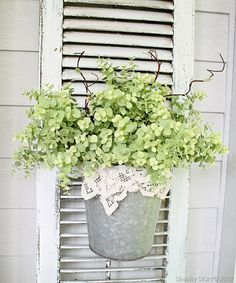 Galvanized Pot With Lace and Greenery on an Old Shutter. Would look cute having the shutter leaning up against cinderblock wall!
