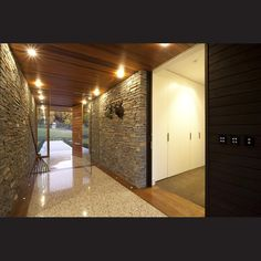 Schist is used as a feature on interior walls, warmed by a cedar ceiling.