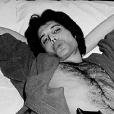 Freddie Mercury. Nice crop of the original image so you can see his adorable face