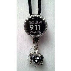Badge Reel Embellished with Beads Attached to 36 inch lanyard.