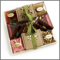 Premium Gift Tray   A fun collection of sweets and treats. Gummy Bears, Deluxe Mixed Nuts, Candy Grapefruit, Chocolate Raisins, Caramel Raspberry Popcorn, Assorted Chocolati Wedges, Macadamia Nuts, Tropical Dried Fruit and Orange Biscotti.