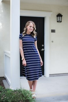 """- Navy + ivory stripes - High neck - Short sleeves 95% RAYON 5% SPANDEX Model is 5'7"""" wearing a small. Runs true to size with a relaxed fit. Small (0-4), Medium (4-8), Large (8-12)."""