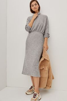 With a butter-soft knit finish, this ribbed dress is sure to be a go-to through the cooler months style it with sneakers for a look that's both sporty and refined.