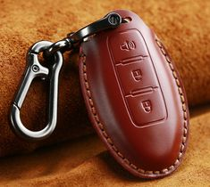 Your keys will be well equipped and can properly withstand light shocks and avoid damage.  It mainly prevents damage as well as effectively protect the wear of the vehicle key during everyday use.   LooK trendy, Keep it simple and be Kovered!   Hand-made stylish old school design. Available in three colors as Black, Brown and Red for this model. Top layer leather with wax string line to match the main color of the cover. Gentle and easy to use print buttons that match those on the key Key Covers, Easy To Use, Main Colors, School Design, Leather Craft, Old School, Keys, Vehicle, Wax