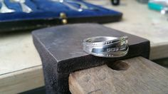 sterling silver spoon turned into a ring. None of this bending metal for me! Silver soldered to a permanent shape
