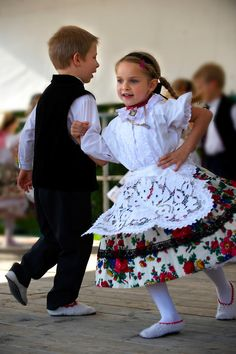 Young Svab children in traditional dress dancing at the wine harvest festival , Hajos (Hajós) Hungary