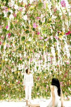 A floating flower garden filled with living flowers that float up and down in relation to the movement of people in the space welcomes the visitors of the National Museum of Emerging Science and Innovation in Tokyo, Japan.