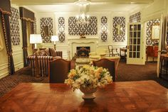 """Plaza Suite Version 2a: Set of the Plaza hotel built on a stage in two versions.  Custom designed flocked wallpaper was the common element between the first """"crummy"""" suite and the second """"General Sherman"""" suite.  As seen in Columbia Pictures' AMERICAN HUSTLE.  Production Design by Judy Becker Photo by:  Alex Linde Plaza Suite, Plaza Hotel, General Sherman, American Hustle, Columbia Pictures, Custom Design, Two By Two, Building, Theater"""