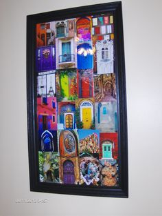 Printed out pictures of amazing, colorful, unusual doors from Pinterest, put them in a large frame i picked up at GW, painted it, and made a collage. Beautiful!