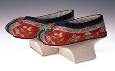 Manchu Woman's Shoes  Unknown Artist  1900-1910 Red silk satin with multicolored silk cord and brocade ribbon Chinese overall: H. 15 x W. 27 cm; H. 5 7/8 x W. 10 5/8 in MWCH66:3  Murray Warner Collection of Oriental Art
