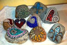 Fun pops of color in your garden with these diy stained glass mosaic river rocks!