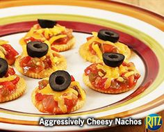 14 mins to make, serves 4 -- INGREDIENTS (Vegetarian) -- CONDIMENTS • 2 tbsp Black olives • 1/3 cup Salsa SNACKS • 12 Ritz crackers DAIRY • 1/2 cup Cheddar and monterey jack cheeses