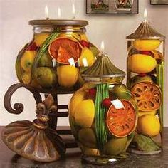 decorative bottlesfilled with oil & furit | andles -