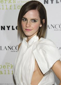 Dare to bare: Emma appeared more than happy with her outfit choice as she smiled for the waiting photographers