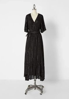 Plus Size Black Short Sleeve Special Occasion Wrap Maxi Dress Women's. Women's Black Short Flutter Sleeve High Low Wrap Maxi Dress With Metallic Stripes Women's Plus Size. Black plus size wrap dress features metallic stripes, flutter sleeves, V-neckline at the wrap-front, and asymmetrical tiered High Low hem. #PlusSizeDresses #getthelook #PlusSize #PlusSizeFashion #PlusSizeStyle #CurvyGirl #plussizedivas #boldcurvyfashionista #curvy #curvyfashionista #Fashion #Style