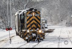 Switchin' in a Winter Wonderland - A Grafton & Upton Railroad Saturday Extra assembles their train in the railroad's North Grafton, Mass. yard among a fresh snowfall still clinging to the trees.