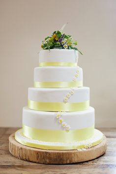 Buttercup yellow wedding cake. Photography by www.victoriaphippsphotography.co.uk