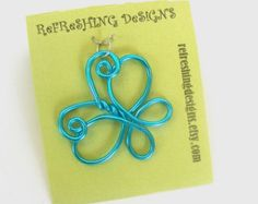 This is a sweet little pendant that I have named Guardian Angel becuase of its subtle angelic look. Made of solid anodized aluminum wire. It is hypoallergenic and lead and nickel-free. Its also light weight and hangs beautifully from a necklace! (Necklace cords and chains can be purchased separately in my shop.)  Comes in 3 different sizes as seen in the pictures. Small 1 1/2 tall, Medium 2 tall, Large 2 1/4 tall. You also get to choose from 20 different colors!!!  *** All photos AN...