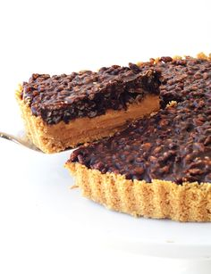 This is the pie of my dreams.  It is both sweet and salty,smooth and crunchy, light and hearty.AND it is  perhaps the easiest pie you will ever make. You don't even need to turn on  the oven. #winning  With a crumbly cookie base and a creamy peanut butter filling, this no bake  Peanut Butter Chocolate Crunch Pie is finished with a crispy chocolate  topping made from chocolate ganache and Rice Krispies! Who's with me?  I love peanut butter desserts. If you think the combo of peanut…
