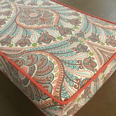 A gorgeous paisley meets-peacock-plume fabric in a coral and clay grey combo with a hit of acid lime green and aqua blue and cream. This fabric is suitable for