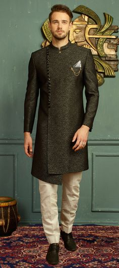 Buy Black Jacquard Angrakha Sherwani online, SKU Code: This Green color angrakha sherwani for Men comes with Jacquard Art Silk. Wedding Dress For Boys, Blazer For Men Wedding, Wedding Kurta For Men, Wedding Dresses Men Indian, Wedding Outfits For Men, Engagement Dress For Men, Wedding Sherwani, Gown Wedding, Wedding Wear