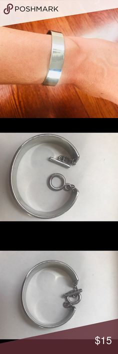 Guess Silver Bangle with Clasp Cute and classic silver bangle. Has a toggle clasp.  Space between clasp connection is 1 inch.  Width of the bracelet is a .05 inches.  Minor scratches. Guess Jewelry Bracelets