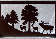 Tableau silhouette en bois représentant le brame du cerf, accompagné de ses…