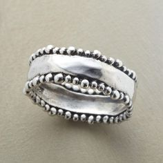 BEADED BORDERS RING -- Tiny beads parade along the wavy perimeters of our hand hammered sterling silver ring.