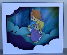 """Card I made using the Cameo """"5x7 easter shadow box card"""" cutting file. I attached the Precious Moments images to the middle layer with button thread."""