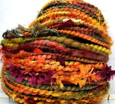 I know I should be thinking Spring, but I just love autumn colors!  HandSpun FunctionArt Art Yarn Autumn Leaves by Kitty Grrlz Hand Spun Yarns, $ 47.00
