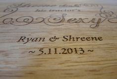 Close-up detail of the precise focus of a laser-etched wooded cutting board given as a personalized photo wedding gift.