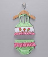 The approaching season brings with it all sorts of family get-togethers and backyard pool parties. And no suit is more perfect for your little one to lounge in the sun in than this precious bikini-style sun suit with a gingham print, ruffles and ice cream smocking.Includes top and bottoms65% cotton / 35% polyesterM...