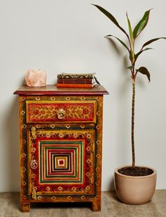 Warm, earthy tones in traditional floral designs instatntly transcends your space to India. This extremely intricate side table is completely hand painted by skilled artisans for a truly authentic look. #earthboundtrading #furniture #homedecor