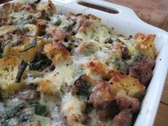 Made this for Easter Brunch and it was amazing! - Breakfast Strata with Greens, Gruyere, andSausage