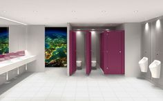 Digital imagery on white rock creating a unique tailored washroom for your company. Washroom design also includes premium urinals and toilets.