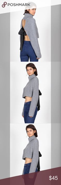 Venus Knitted Bow Back Sweater This gorgeous open back w/ Tie turtleneck sweater is super cozy and very pretty on. Features open back with black lace bow in back that you can tie and wear how you like loose or tight. * 100% acrylic  * Color Heather Grey * Model is wearing size small 33-25-36 * Turtleneck  * Open-Back with black bow  * True to size anawatboutique Sweaters Cowl & Turtlenecks