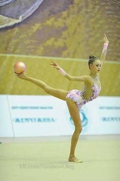 Maria Titova | That has to involve strength, balance, & control of a high level. She is gripping the ball with her foot. And balancing with this weight on her outstretched leg. Rhythmic gymnasts are amazing.