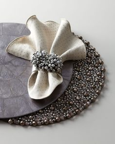http://archinetix.com/kim-seybert-gunmetal-gray-table-linens-p-3016.html