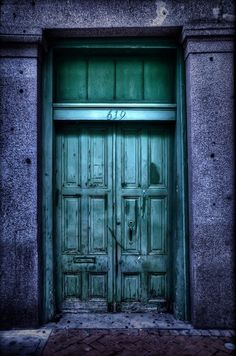 The sheeny, beetle-green hue of this front door has a slightly mysterious air