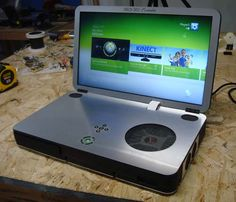 Portable Xbox 360.  Love these every time I see one.  Still waiting to see one w/ its own battery that can last long enough!