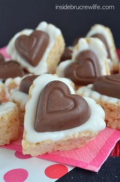 White Chocolate Reese's Krispie Hearts - rice krispie treats topped with white chocolate and a Reese's peanut butter heart.