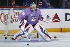 Henrik rocking the purple during warm ups for Hockey Fights Cancer