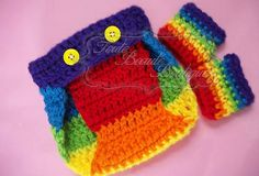 Rainbow Diaper Cover and Fingerless Gloves Set Shown in a 0-3 months for diaper cover and 0-6 months for fingerless gloves. available in custom color(s) and sizes from preemie to 12 months for cover and preemie to adult in gloves! Order yours today! www.facebook.com/TouteBeauteBoutique www.Pinterest.com/TouteBeaute #Crochet #handmade #prop #photo #rainbow #gloves #fingerless