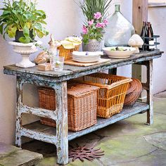 An antique buffet might be too shabby for the breakfast nook, but its chipped paint and warped boards feel right at home on a patio. Plates and dishes of food cluster on its tabletop, while the lower shelf holds baskets filled with other essentials.