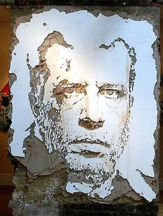 street art..portrait in decaying wall by alexandre farto