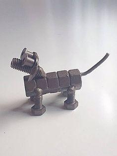 Soldado con autógena perro arte de escultura de tuercas y