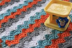 cute knitted baby blanket chevron zig-zag blue orange gray striped