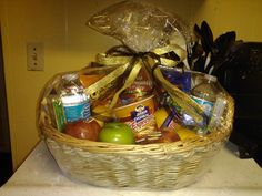 Gift basket for a minister.  Includes water, breakfast items, candy, fruit, popcorn, and whatever else I could stuff in there.
