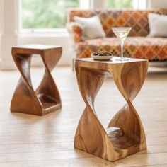 This striking Surin Infinity Table is hand carved from Monkey Pod Wood. Beautiful curves and intriguing spaces add to the unique charm. Infinity Table, Central Table, Monkey Pod Wood, Hand Wax, Beautiful Curves, Wood Grain, Natural Wood, Hand Carved, Carving